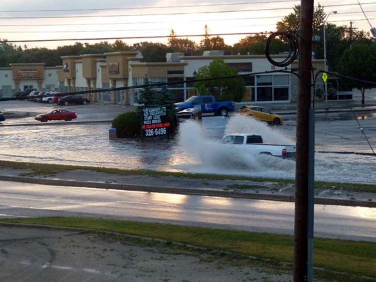 Three inches of rain hit Steinbach in an hour overnight, overwhelming the southern Manitoba city's pumping stations and flooding major roads and a few basements.