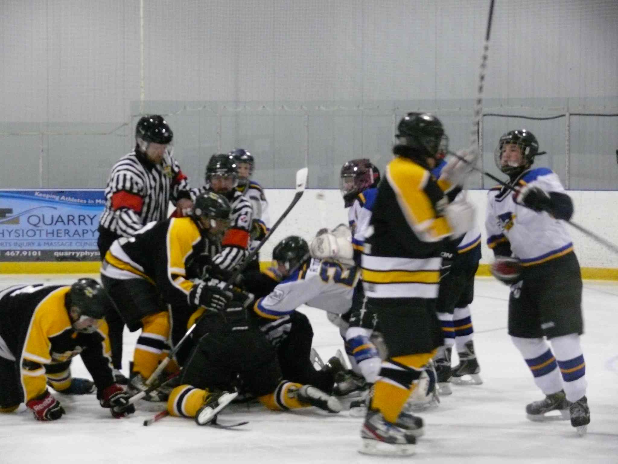 An image from video of a recent on-ice altercation in which an official was assaulted.