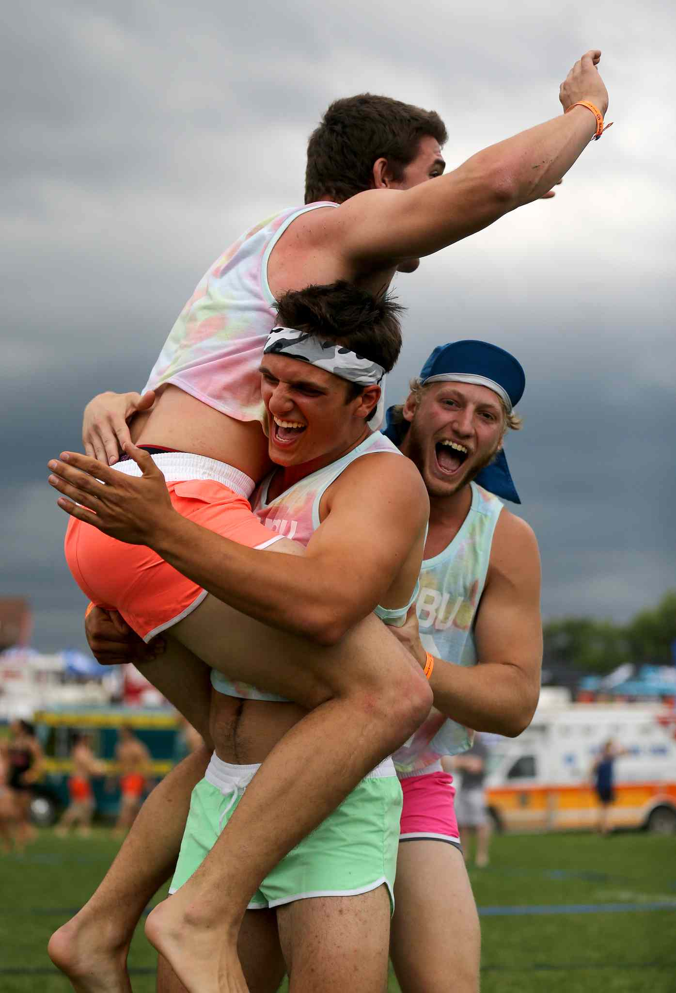 Three members of Poppin Volley's celebrate a point at the Super-Spike volleyball tournament at Maple Grove Rugby Park, Friday, July 18, 2014.