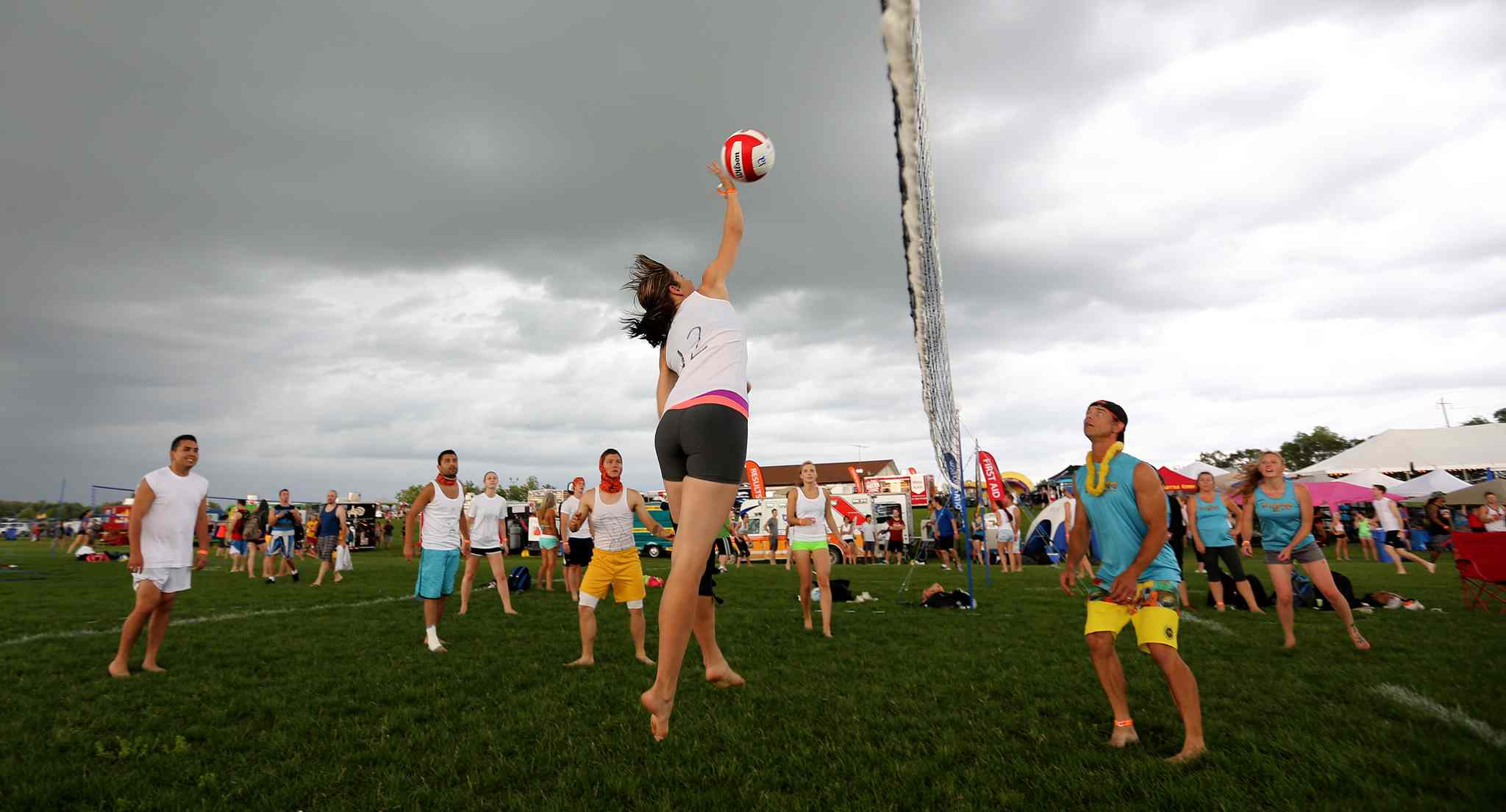 Kristin Robson of Interracial Sets hits the ball during her teams game against Dirty By Day, Electric By Night, at the Super-Spike volleyball tournament at Maple Grove Rugby Park, Friday, July 18, 2014.