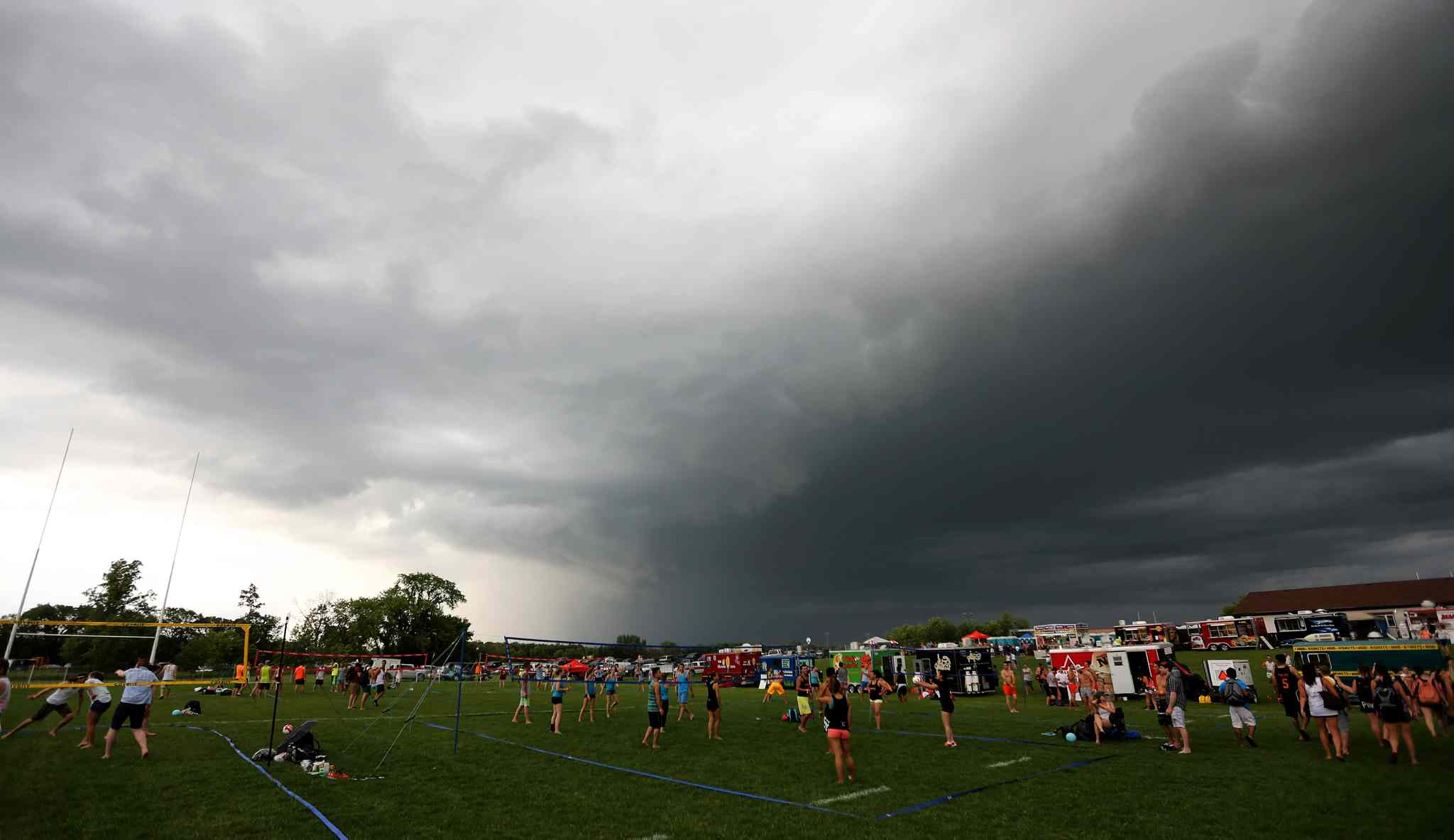 Storm clouds above Super-Spike volleyball tournament at Maple Grove Rugby Park, Friday, July 18, 2014.