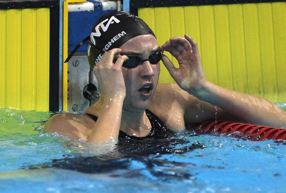 Tia VanLandeghem (Manta) checks clock after her win in the 15 & over final of the 50 meter free with a time of 26.25 at the 2013 Manitoba/Saskatchewan Short Course swimming championships. (JOE BRYKSA / WINNIPEG FREE PRESS)