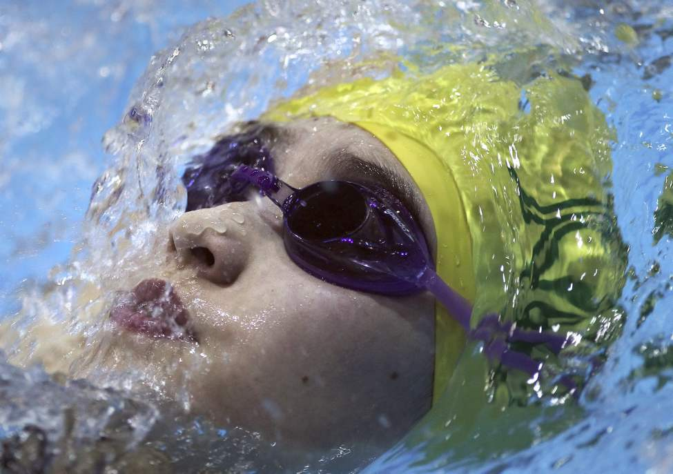 Jessica Wilson (Marlins) swims in the 200 backstroke and a 7th place finish with a time of 2:46.19 Saturday.  (JOE BRYKSA / WINNIPEG FREE PRESS)