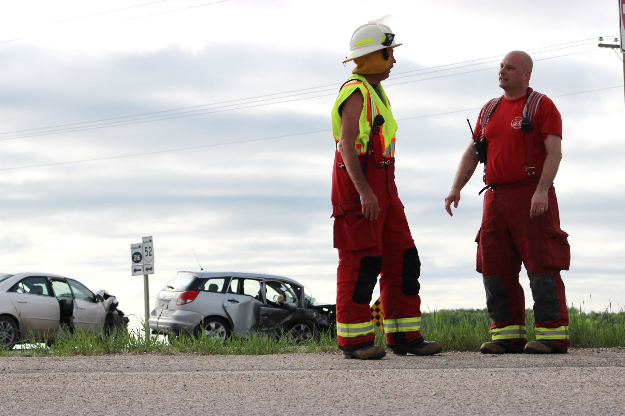 Kleefeld fire department members talk around 7 p.m. Thursday night at the scene of a two-vehicle collision at the intersection of Highway 52 and Provincial Road 216, north of Kleefeld. Police said Friday morning that a 6-year-old boy suffered critical injuries in the crash.