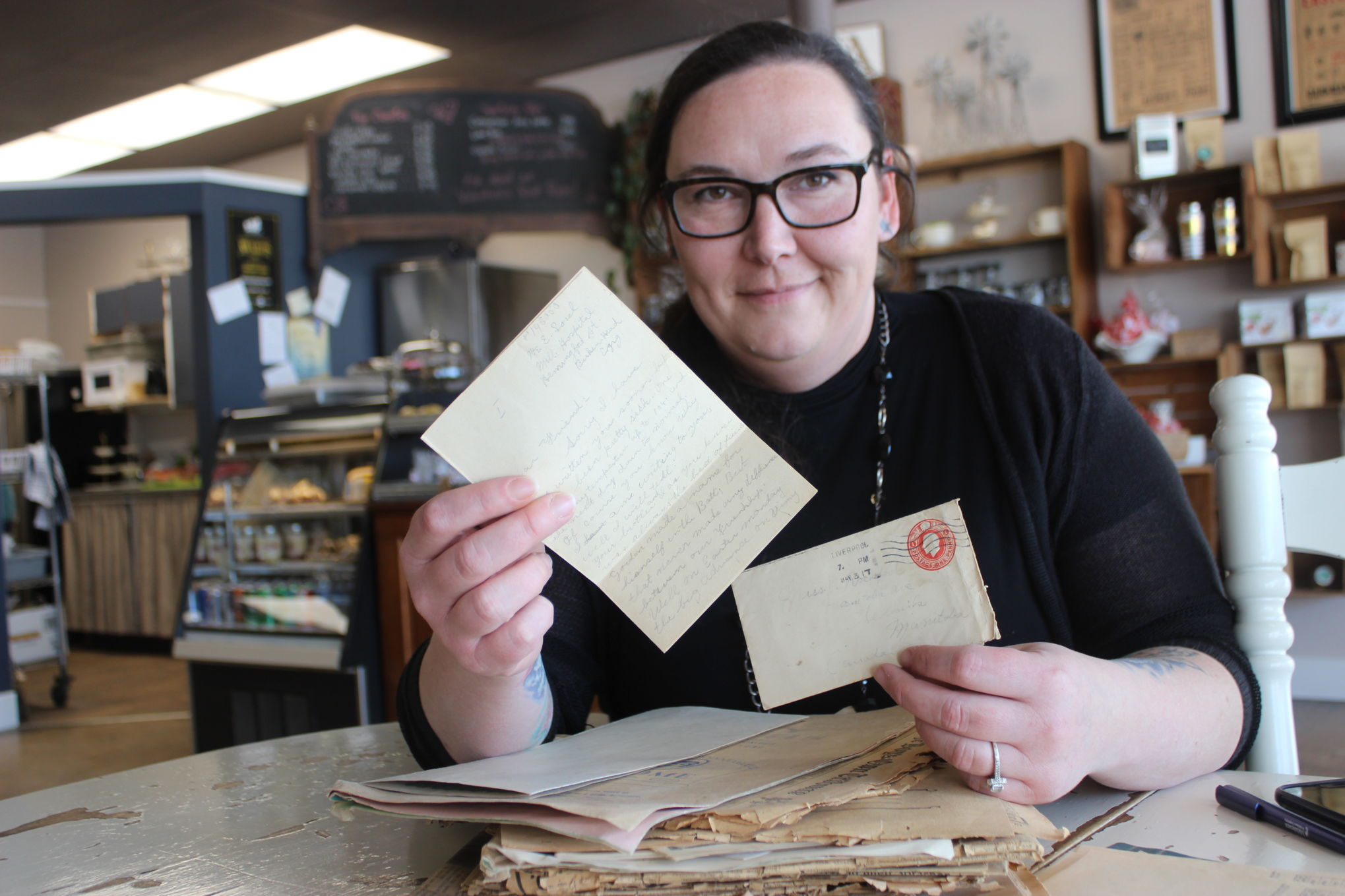 Amanda Kehler of Prairie Pickers Cafe displays the First World War correspondence she discovered in a stack of old newspapers purchased at auction.