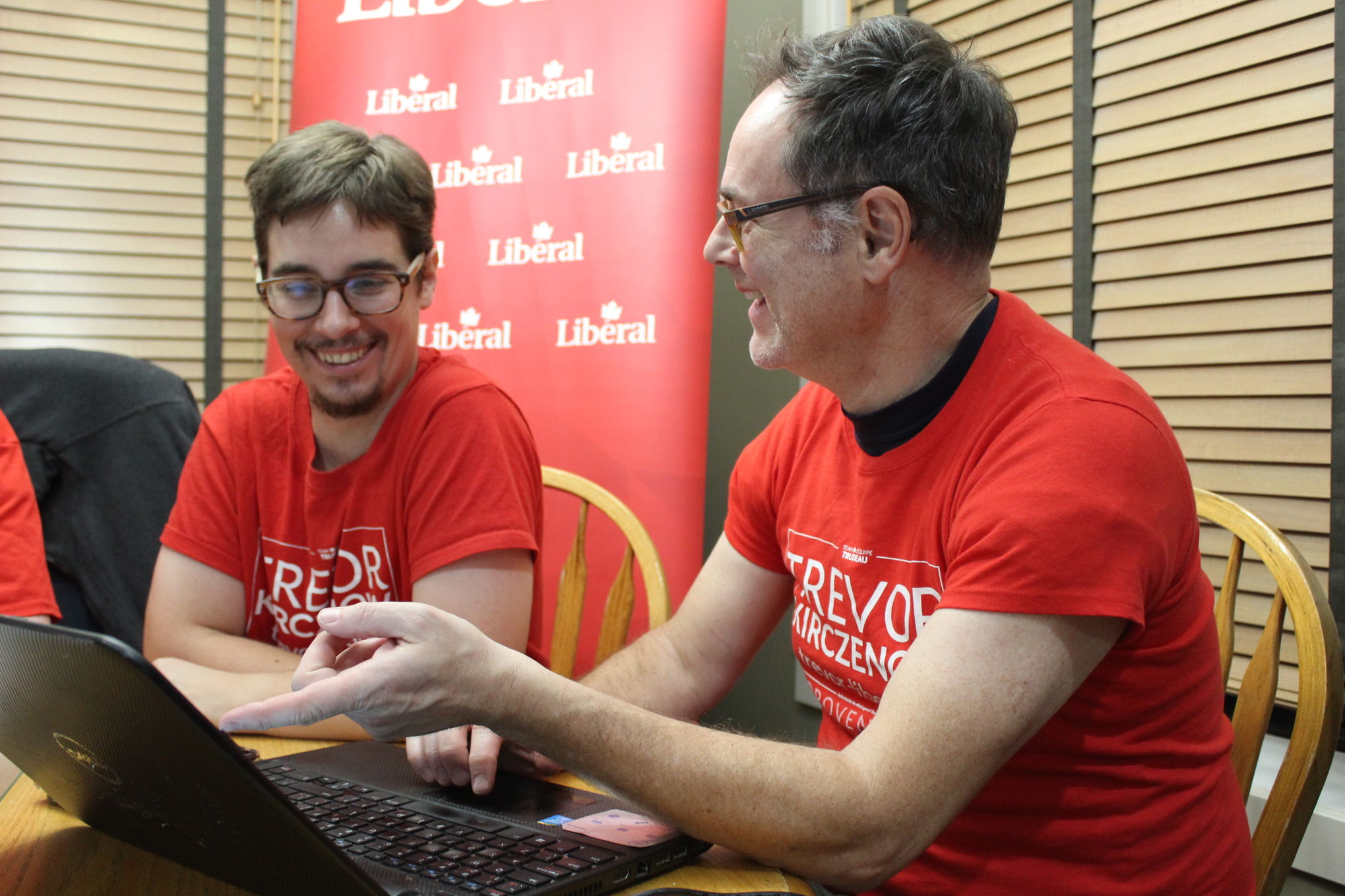 Liberal candidate Trevor Kirczenow and his campaign manager and husband, Ken MacDonald, are all smiles as they look up some election results at a house party in Oakbank hosted by Provencher Liberal president Jim Sykes.