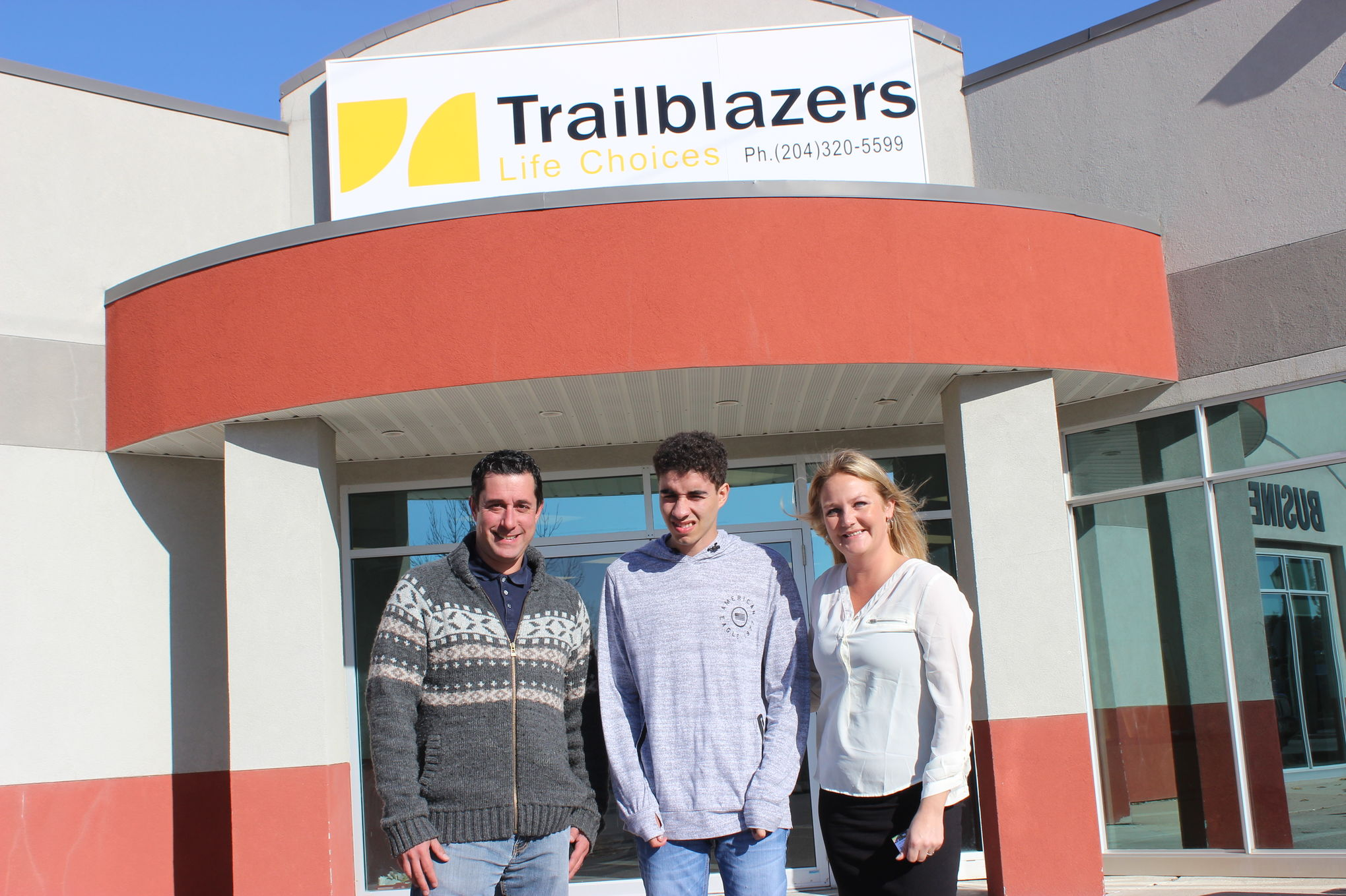 Trailblazers Life Choices executive director Andrew Morris, work experience participant Kanaba Hewitt, and residential and rural programs manager Rayann Kuban are seen outside the non-profit organization's new Steinbach location at B-197 Main Street. Trailblazers provides day services for adults living with disabilities. Its Steinbach expansion marks its first foray beyond Winnipeg.