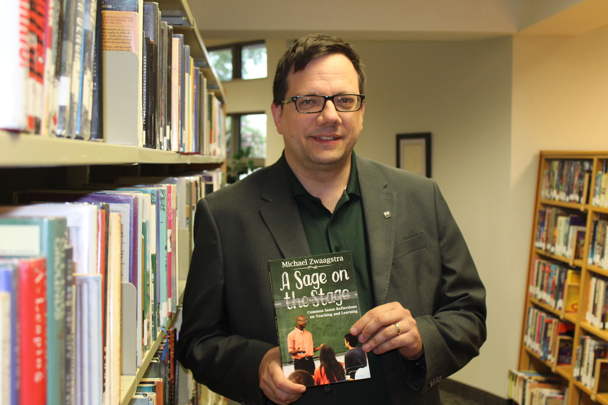 Michael Zwaagstra, a Green Valley School teacher and Steinbach city councillor, displays an advance copy of his new collection of op-eds, A Sage on the Stage, in the Jake Epp Library.