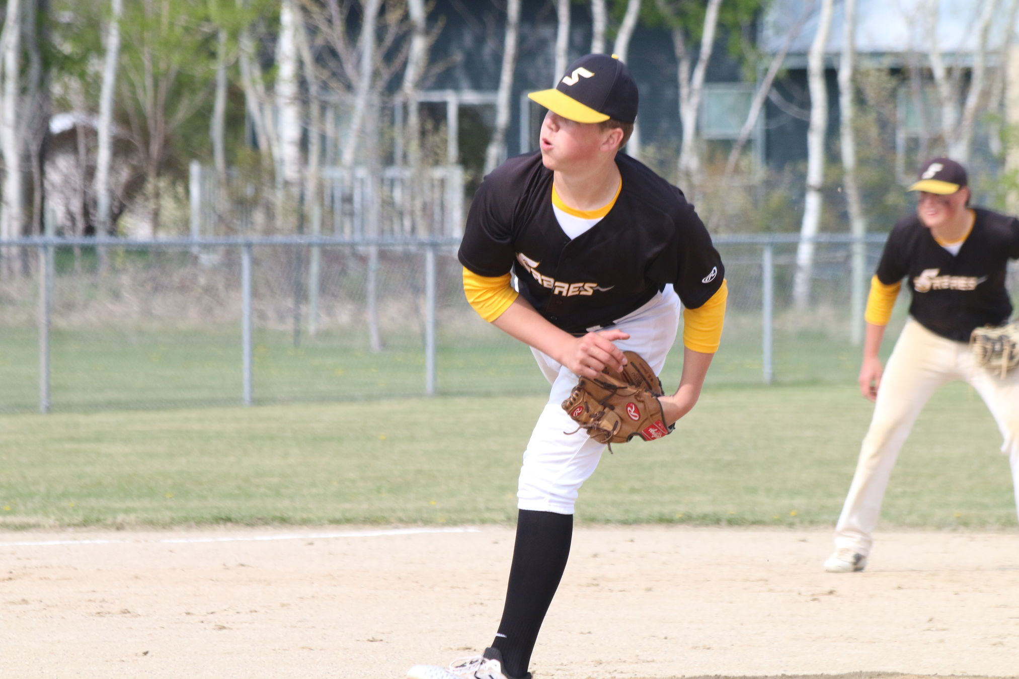 Rylan Penner delivers for the SRSS Sabres during the Zone 13 high school baseball tournament last week in Mitchell. The Sabres, seeded second, begin play Thursday in the Provincial High School Baseball Championships at Optimist Park in Winnipeg.