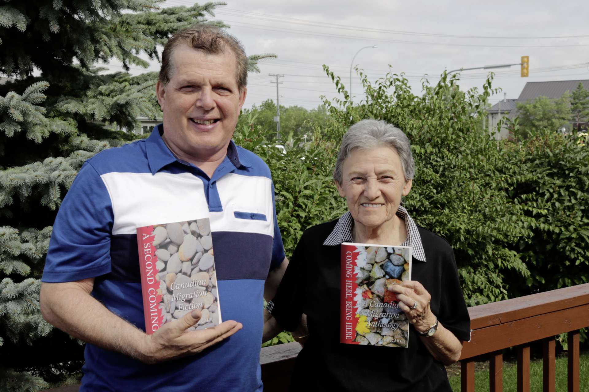 Ron Romanowski (left) and Libby Simon hold the two books in which their stories are featured. They will be at McNally Robinson for a duo-book launch Sept. 23.