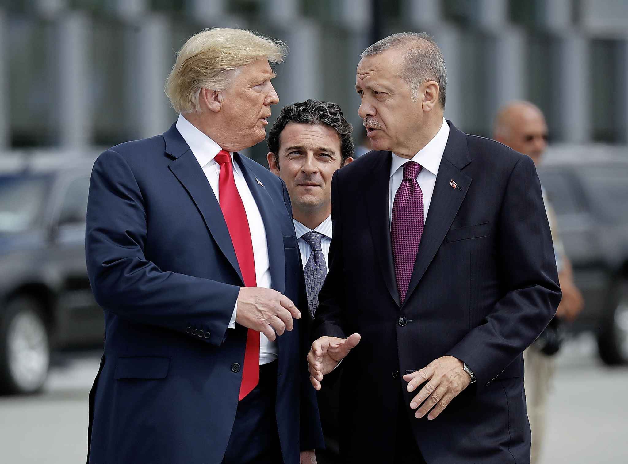 """Donald Trump (left) announced the U.S. forces pullout, hours after going """"off script"""" during a telephone conversation with Turkish President Recep Tayyip Erdogan. (Pablo Martinez Monsivais / Associated Press files)"""