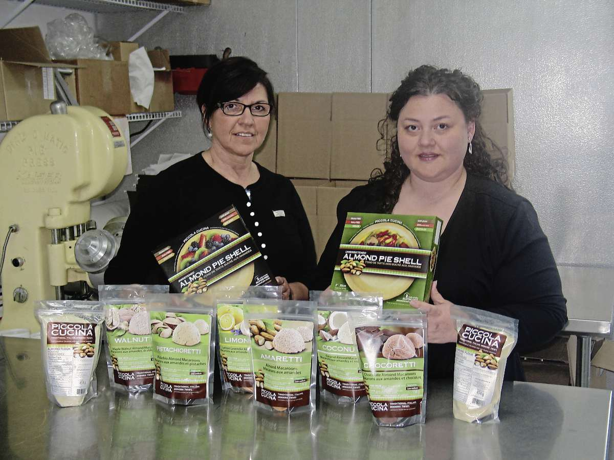 Anita (left) and Pina Romolo pose with a selection of their products which are available at Vita Health, DeLuca's, G.J. Andrews Food and Wine Shoppe, and Co-op Marketplaces