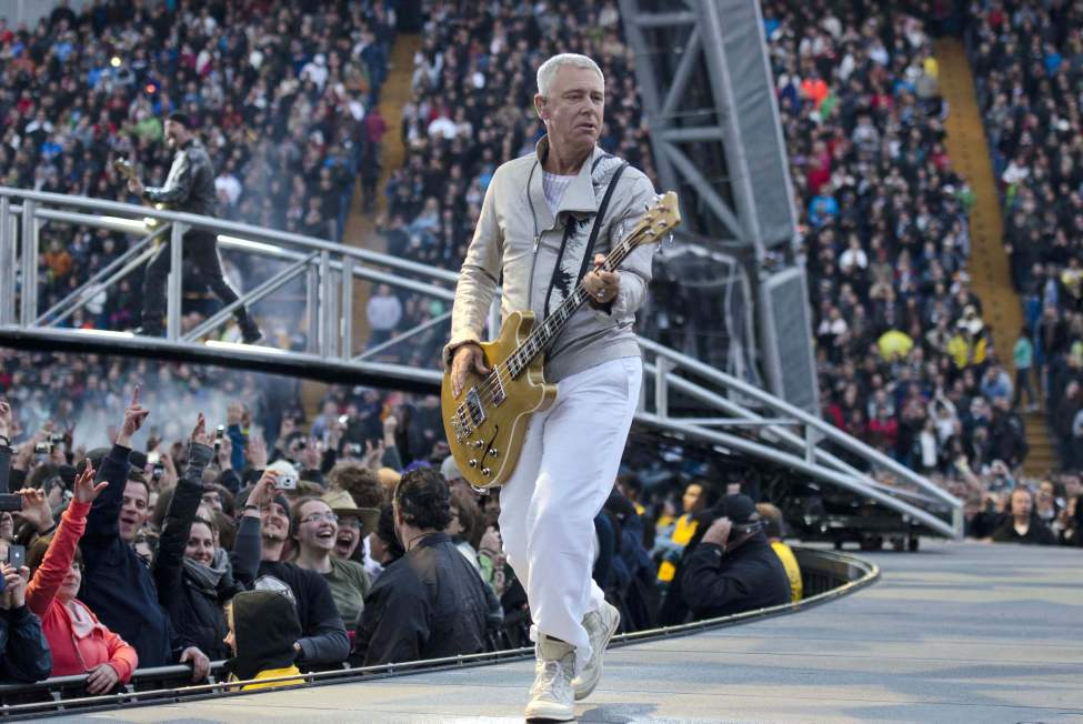 U2 bassist Adam Clayton performs with U2 in concert at Canad Inns Stadium Sunday night. (DAVID LIPNOWSKI / WINNIPEG FREE PRESS)