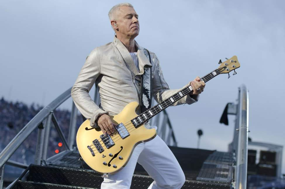 U2 bassist Adam Clayton performs with U2 in concert at Canad Inns Stadium Sunday night.