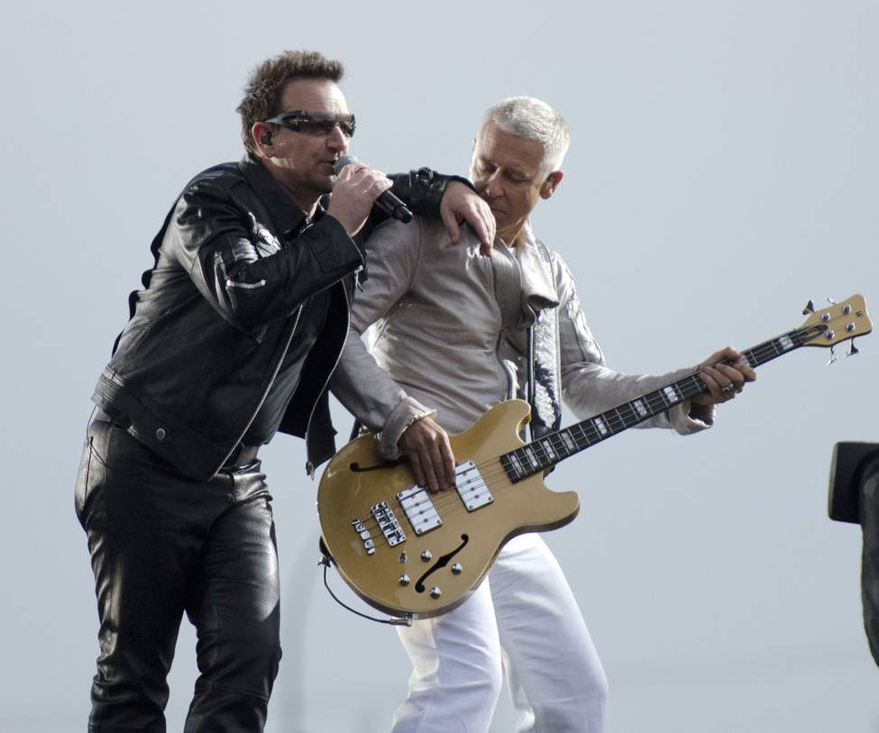 U2 lead singer Bono performs with bassist Adam Clayton with U2 in concert at Canad Inns Stadium Sunday night.