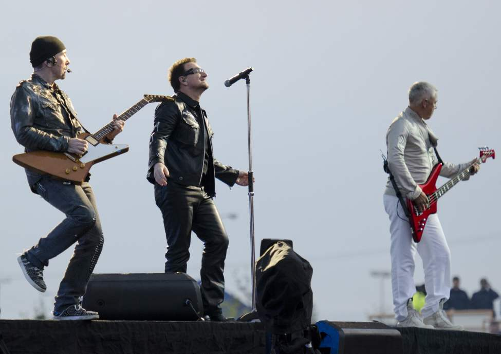 U2 guitarist The Edge, lead singer Bono, and bassist Adam Clayton performs with U2 in concert at Canad Inns Stadium Sunday night. (DAVID LIPNOWSKI / WINNIPEG FREE PRESS)