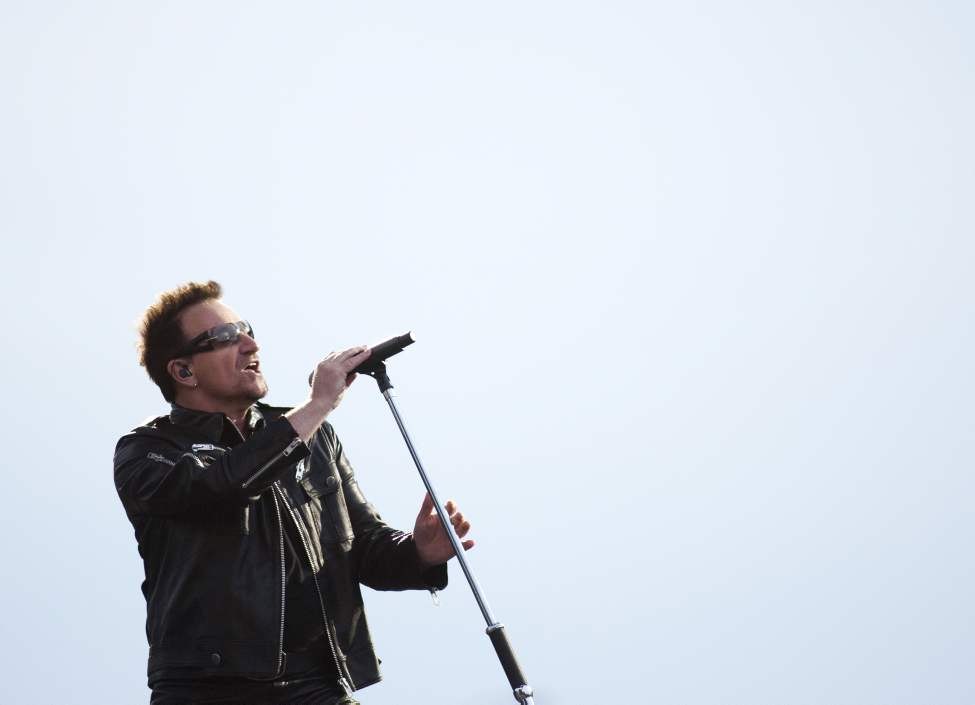 U2 lead singer Bono performs with U2 in concert at Canad Inns Stadium Sunday night.