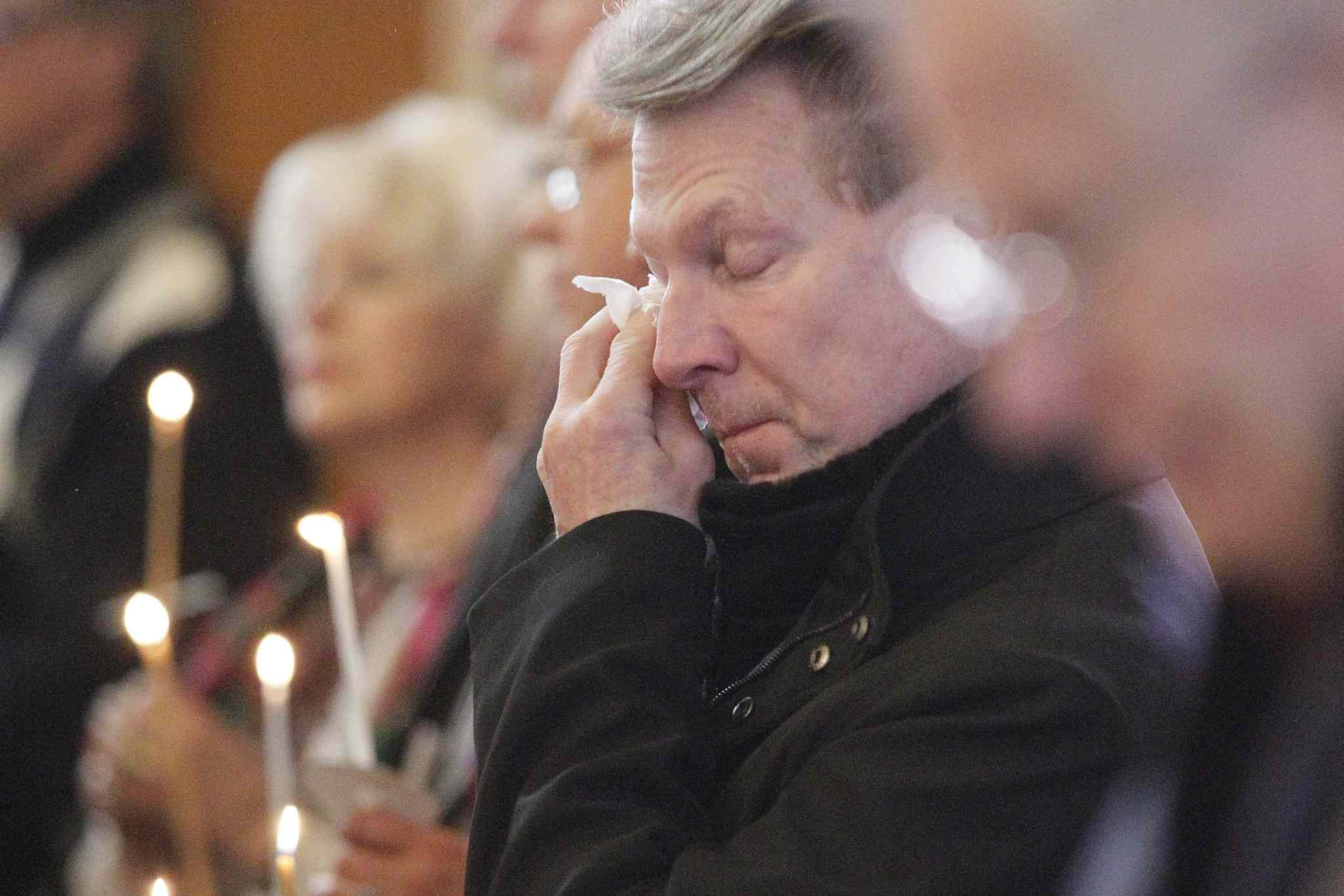 People gathered for a memorial service for victims of violence in Ukraine at Holy Eucharist Ukrainian Catholic Church on Sunday.