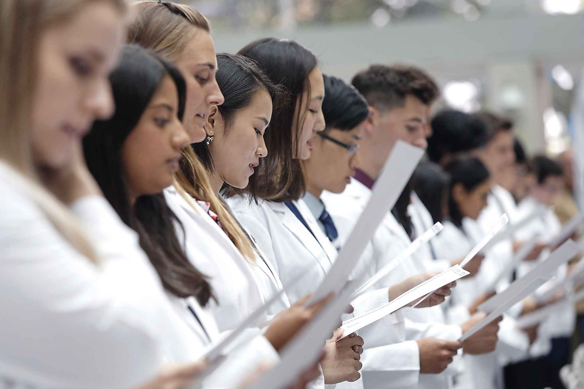 Medical students read the Hippocratic Oath at a White Coat Ceremony at the University of Manitoba. Brian Postl, the university's dean of medicine asked department heads to find contingency plans for filling medical shifts scheduled for 20 Saudi residents and fellows.