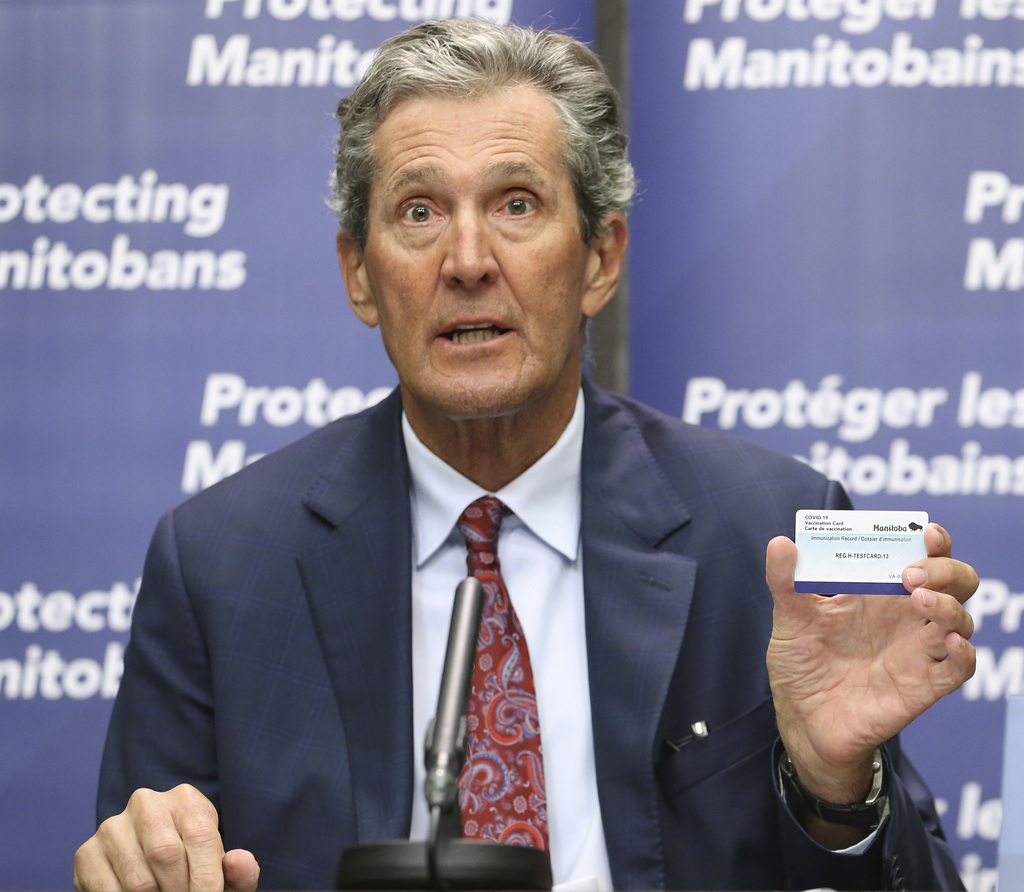 Premier Brian Pallister shows off a proposed proof-of-vaccination card earlier this month. (Kevin King / Pool files)
