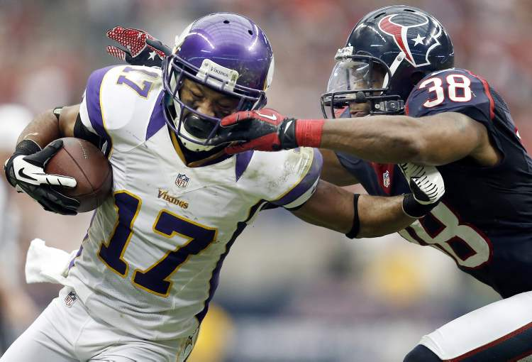 Jarius Right (17) of the Minnesota Vikings was tackled by Danieal Manning (38) of the Houston Texans during the fourth quarter at Reliant Stadium on Sunday in Houston, Texas. Manning was called for a facemask penalty. The Minnesota Vikings defeated the Houston Texans, 23-6. (Tribune Media MCT)
