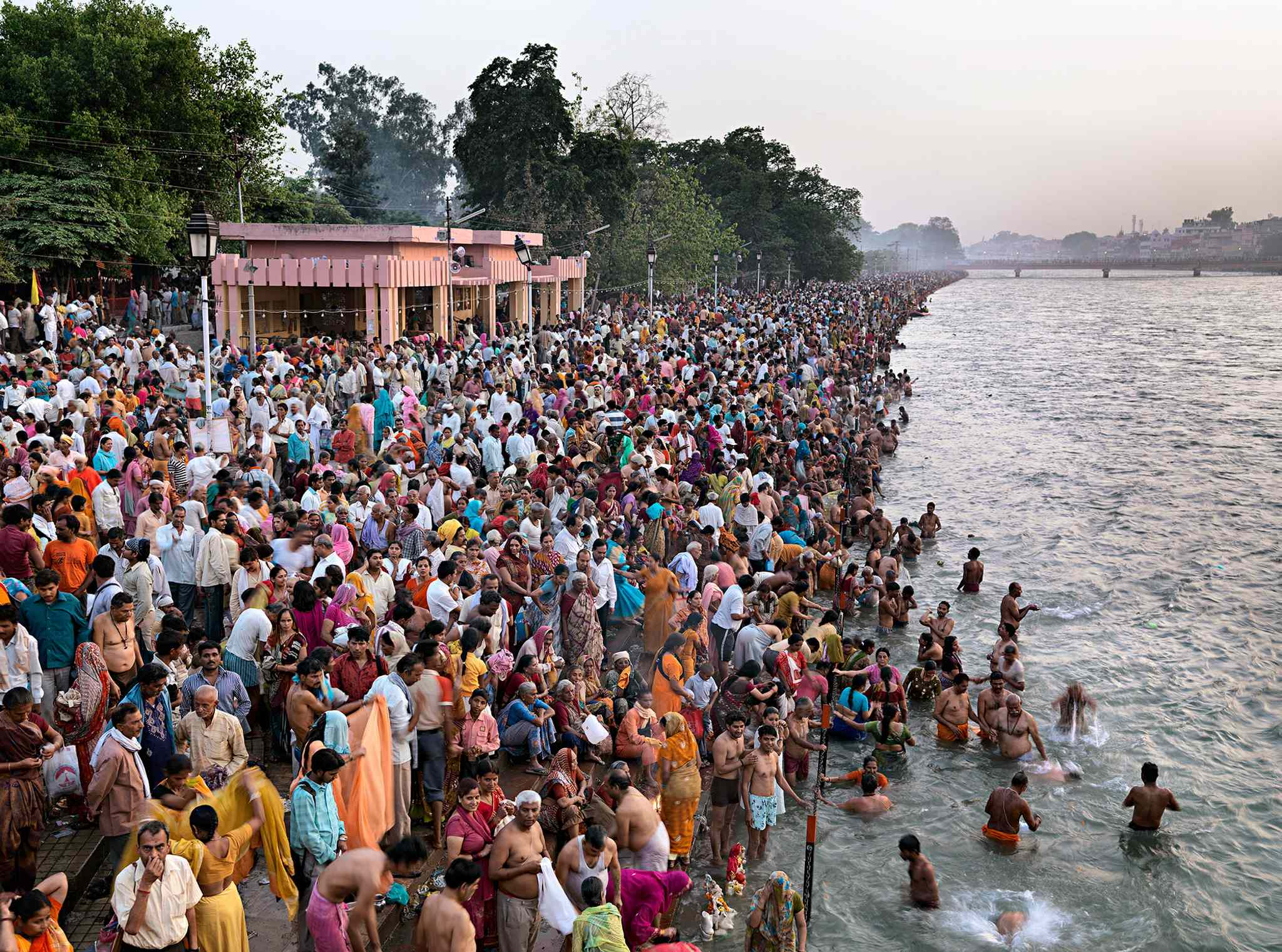 Devout Hindus gather to bathe where the Ganges and Yamuna rivers meet.