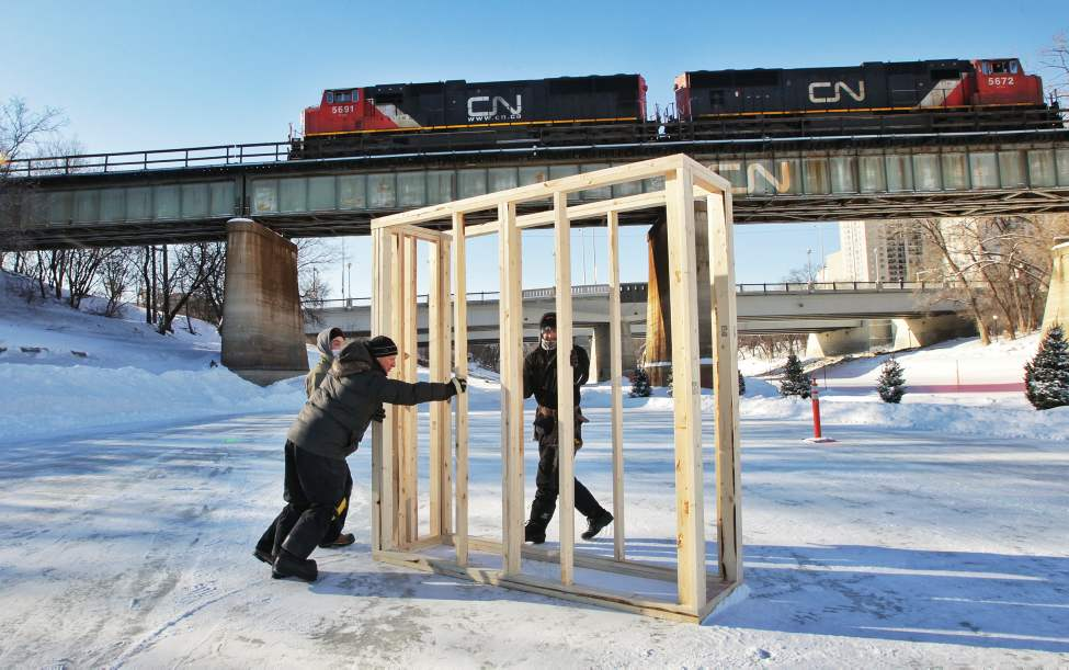 A crew from Garnet Construction starts work on a warming hut on the river trail at The Forks. The hut titled Big City will be made of several of these framed blocks and will be wrapped in a Tyvec, a type of plastic used in building construction.  (Mike Deal / Winnipeg Free Press)