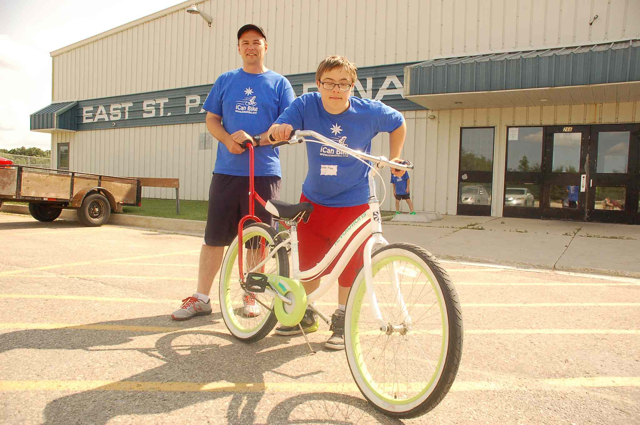 iCan Shine bike camp host Sean Frain is shown with son Liam at East St. Paul Community Centre.
