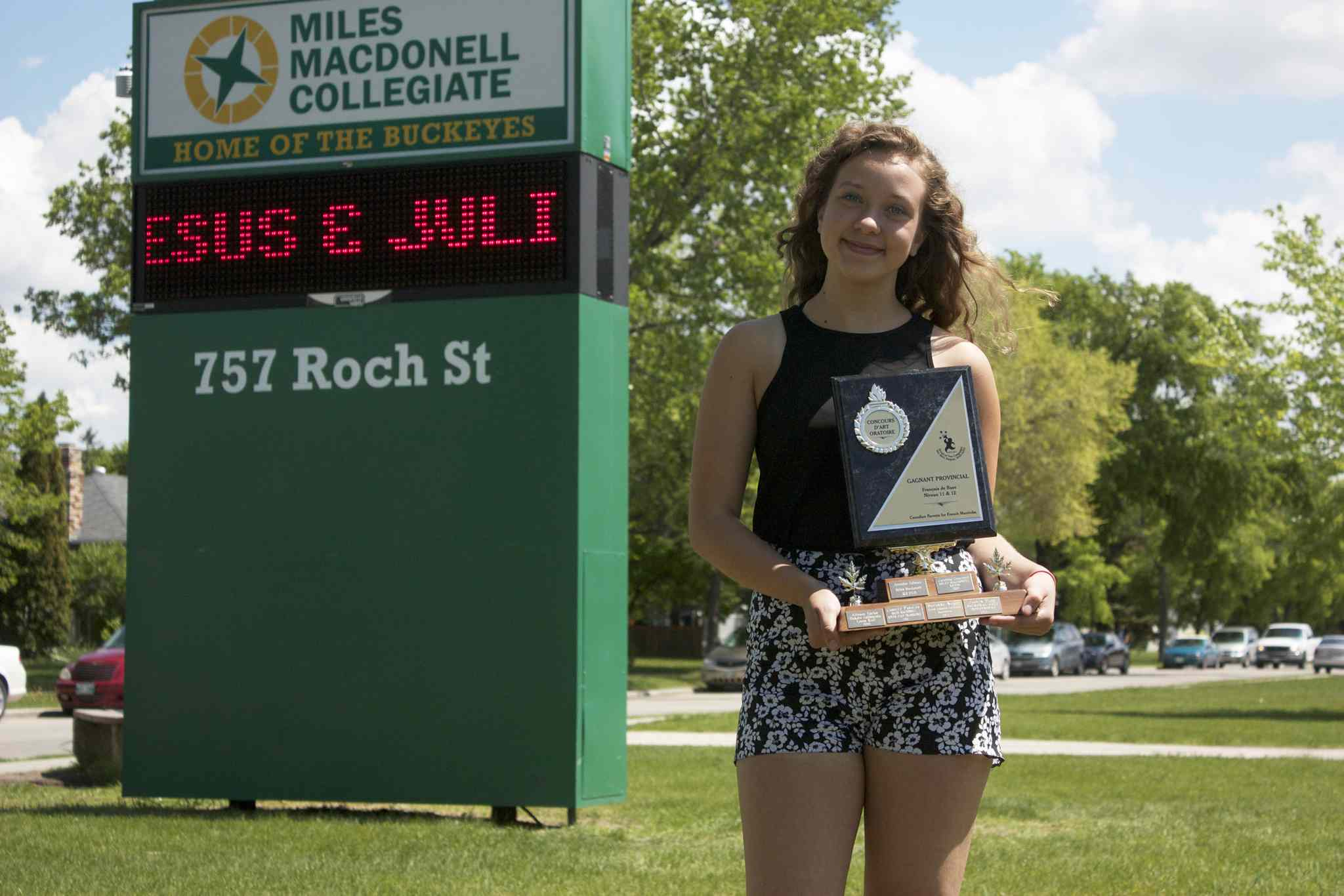 Miles Macdonell Grade 11 student Kayla Peters is shown with the trophy from the provincial Concours d'art oratoire at the school. Peters also finished second at the national competition in Charlottetown, P.E.I. last month.