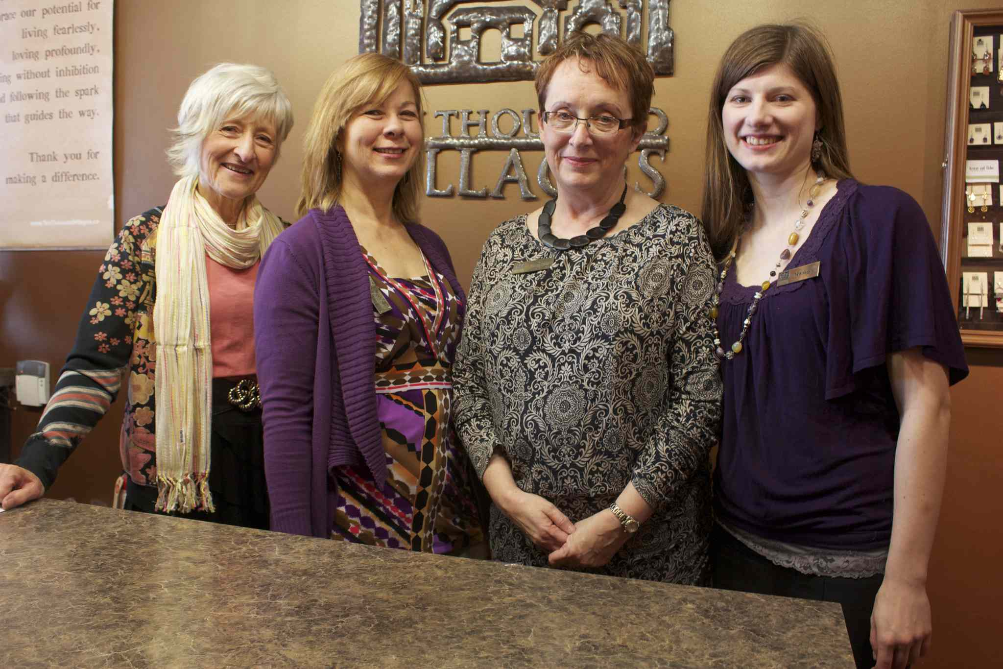 Ten Thousand Villages volunteers Pat Bryski, Susie Slobodian, and Maureen Cowling are shown with store manager Jessica Schmidt.