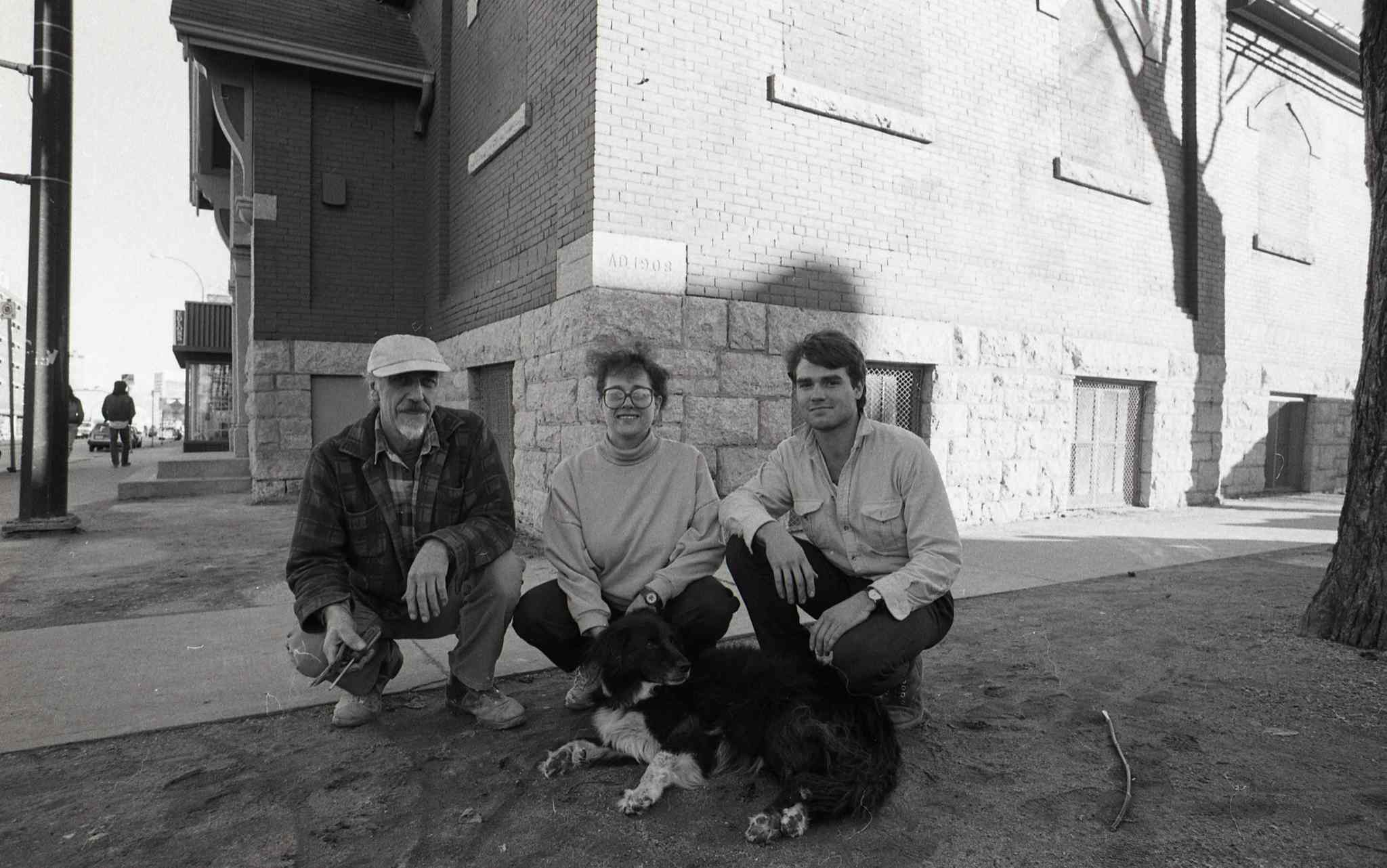 Harry Paine, Ava Kobrinsky and Craig Skene (with dog Buffy) outside the WECC in October of 1987.  (Gerry Cairns / Winnipeg Free Press files)