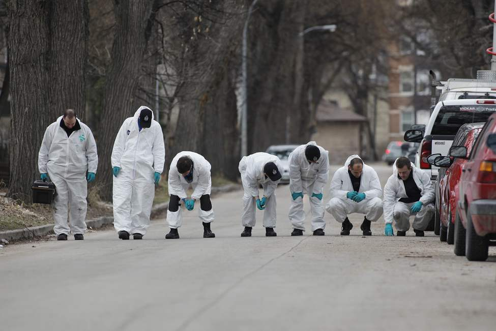 Winnipeg police investigate in front of 238 Balmoral Monday April 2, 2012. Johnathen James Felix was shot outside the residence Sunday April 1, 2012.  Winnipeg's 9th homicide of 2012