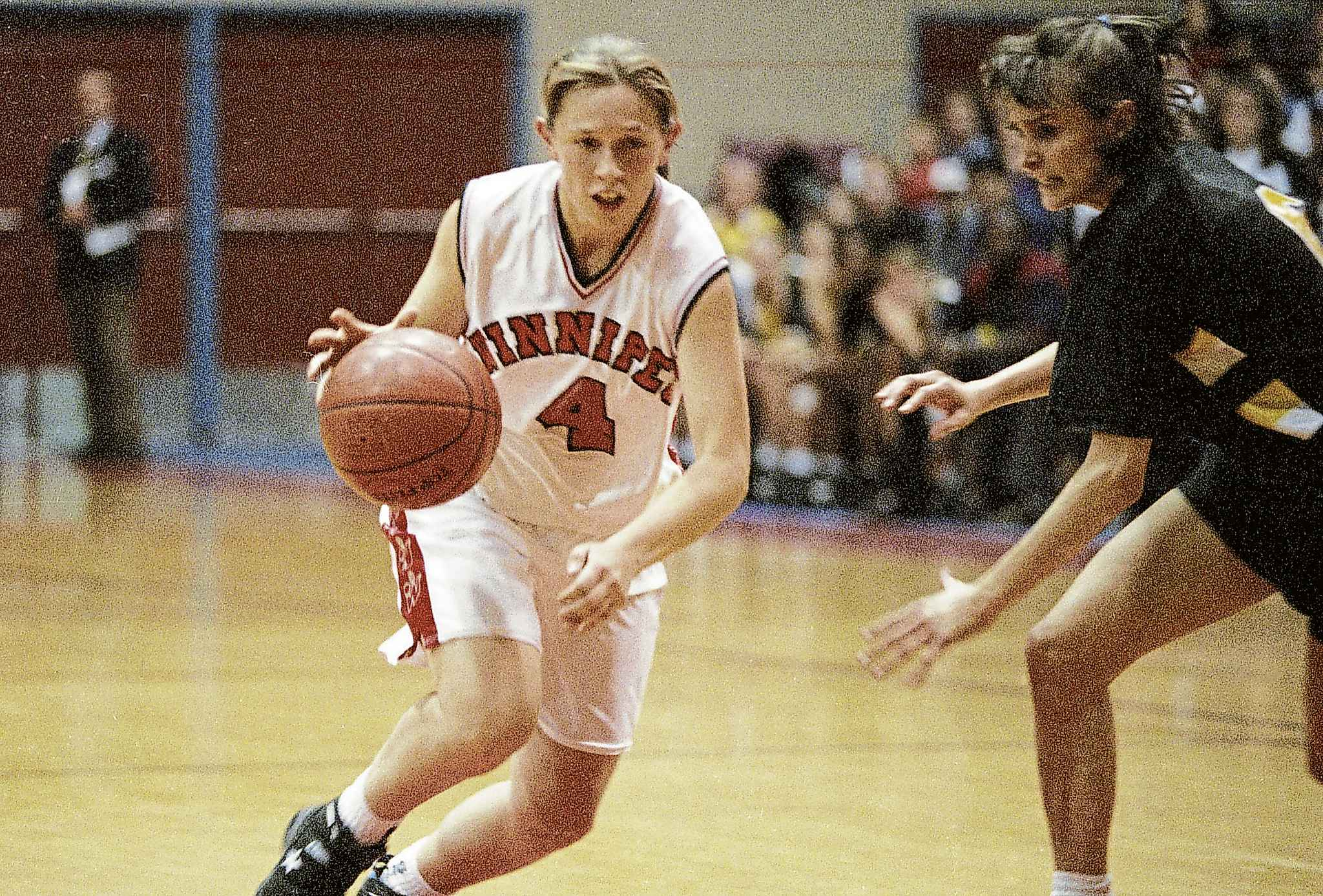 University of Winnipeg Wesmen Sandra Carroll works her way around a University of Manitoba Bison player during the game on December 2, 1994.