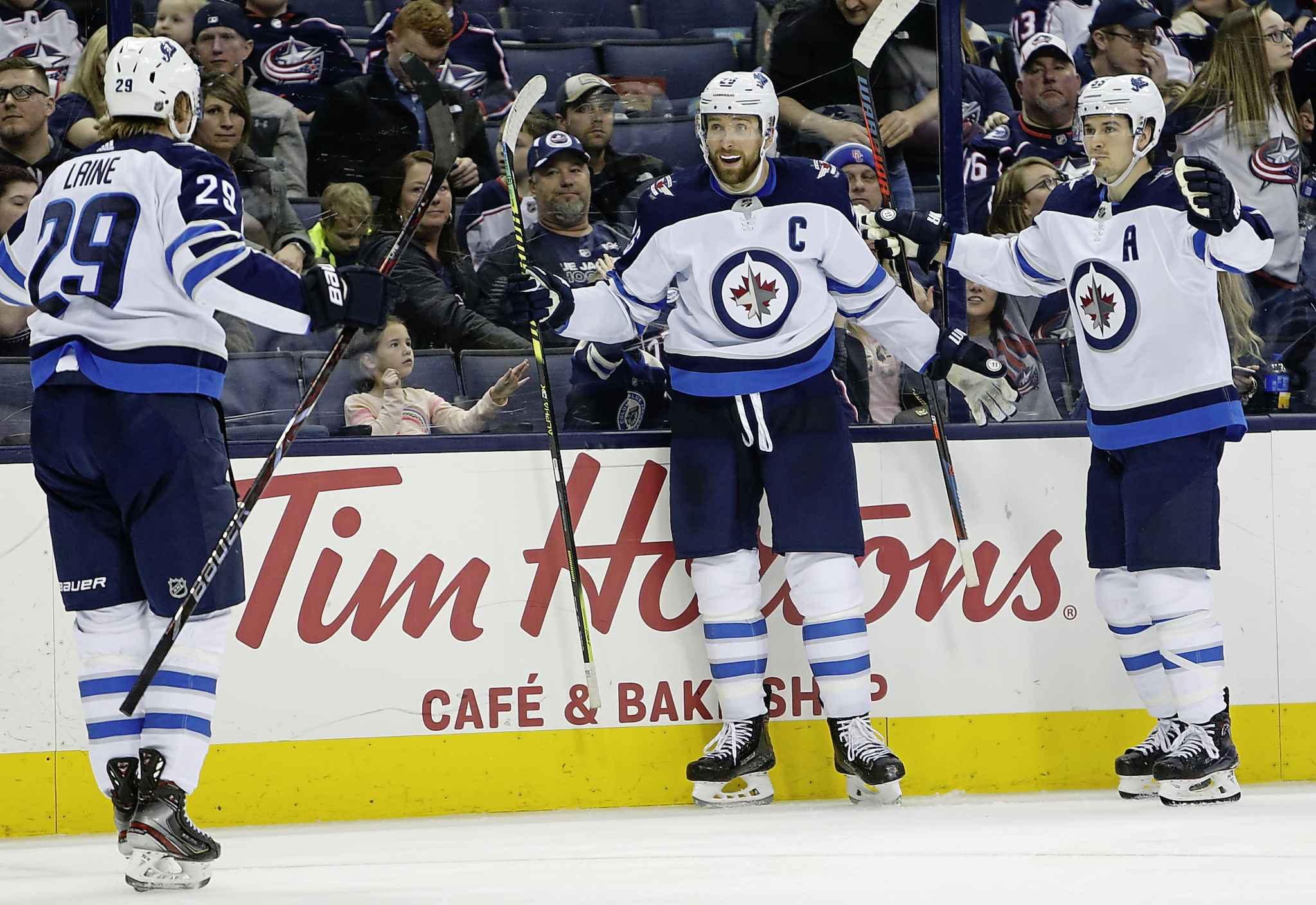 JAY LAPRETE / THE ASSOCIATED PRESS</p><p>Winnipeg Jets' Blake Wheeler, center, celebrates his goal against the Columbus Blue Jackets with teammates Patrik Laine, left, of Finland, and Mark Scheifele during the third period of an NHL hockey game Sunday, March 3, 2019, in Columbus, Ohio. The Jets beat the Blue Jackets 5-2.</p>