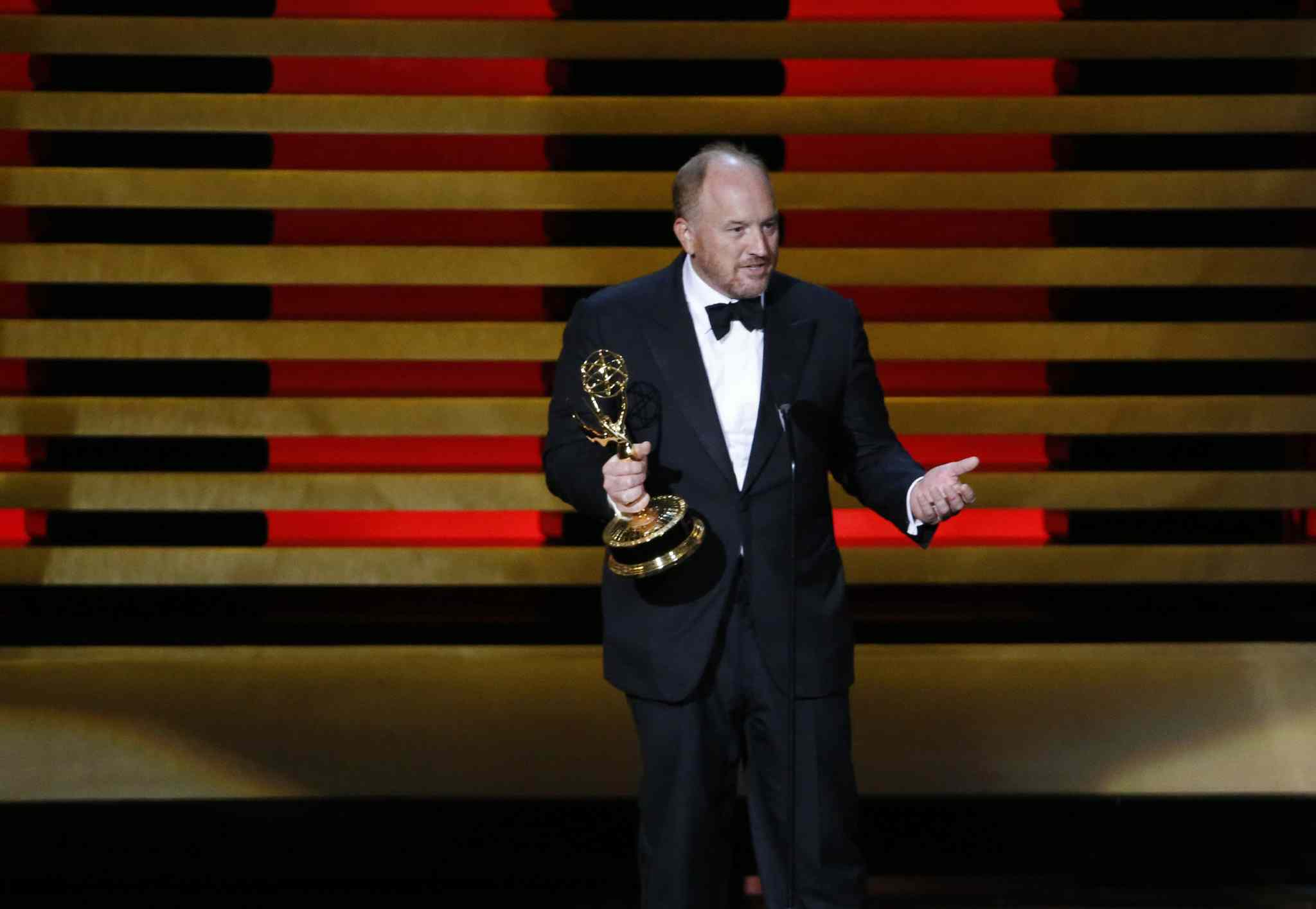 Louis C.K. accepts his Emmy for comedy series' writing for Louie.