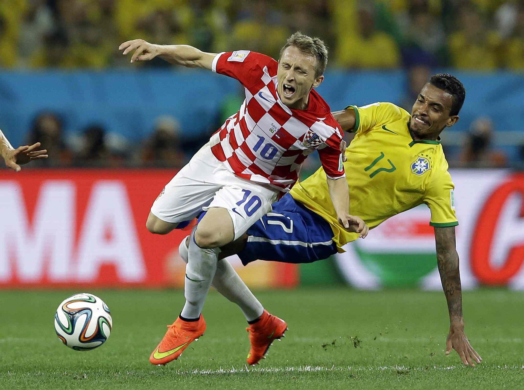 Croatia's Luka Modric is fouled by Brazil's Luiz Gustavo, right, during the group A World Cup soccer match on Thursday.