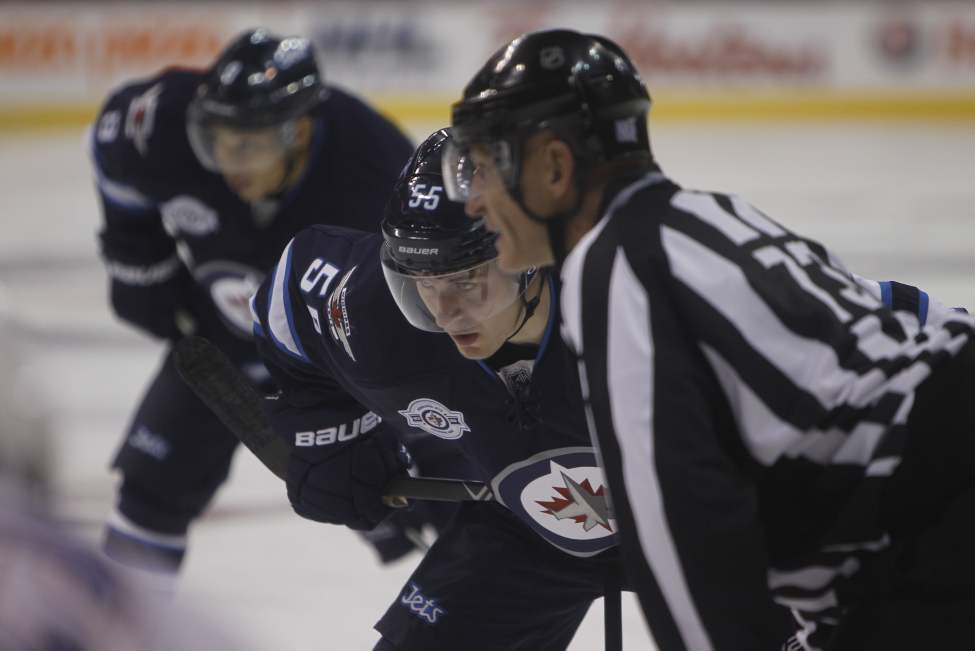 Mark Scheifele faces off during second-period action. (Trevor Hagan / Winnipeg Free Press)