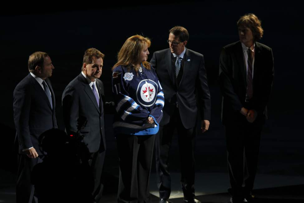 A special ceremony for Rick Rypien before the game took place with Gary Bettman, Craig Heisinger, Shelley Crawford (mother), Mark Chipman and David Thomson. (Boris Minkevich / Winnipeg Free Press)