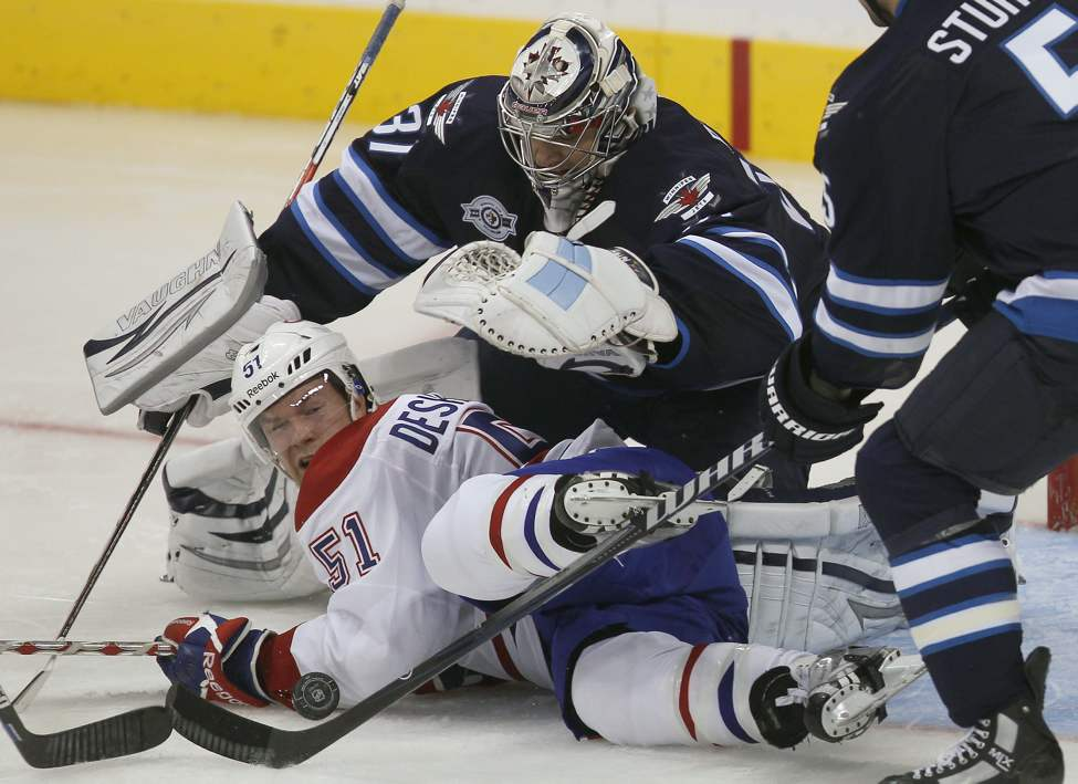 Canadien David Desharnais is stopped by Ondrej Pavelec during second-period action. (Joe Bryksa / Winnipeg Free Press)