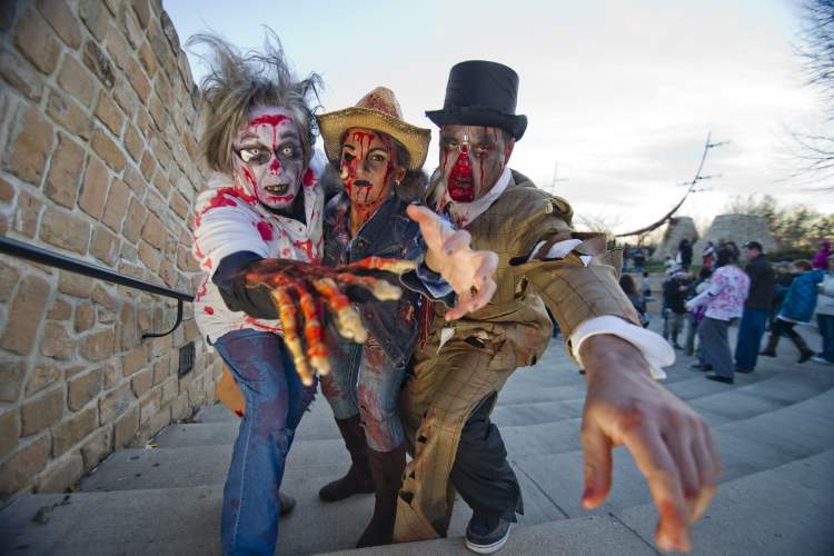 Zombies Heather McKnight (from left), Robyn Mauthe and Ron Parker participated in the annual Winnipeg Zombie Walk from The Forks to The Manitoba Legislative Building Saturday night. 