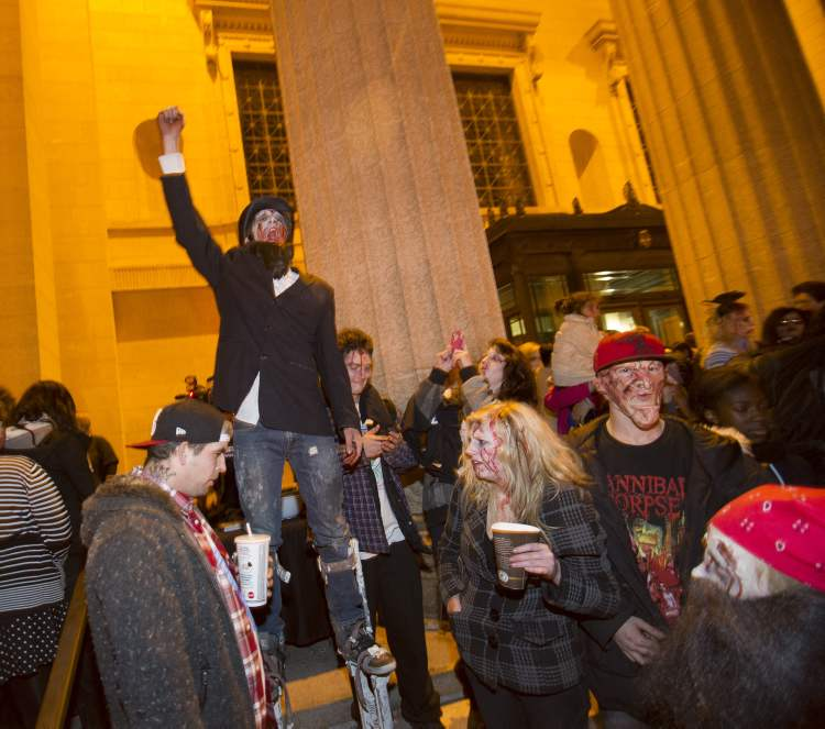 Zombie Abraham Lincoln during the annual Winnipeg Zombie Walk from The Forks to The Manitoba Legislative Building Saturday night. 