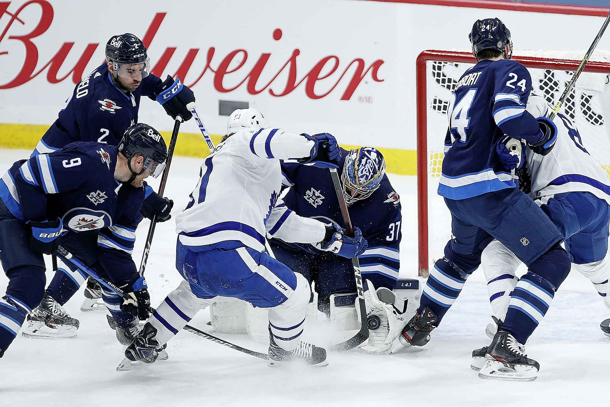Winnipeg Jets goaltender Connor Hellebuyck (37) saves the shot from Toronto Maple Leafs' John Tavares (91) during the first period. (John Woods / The Canadian Press)