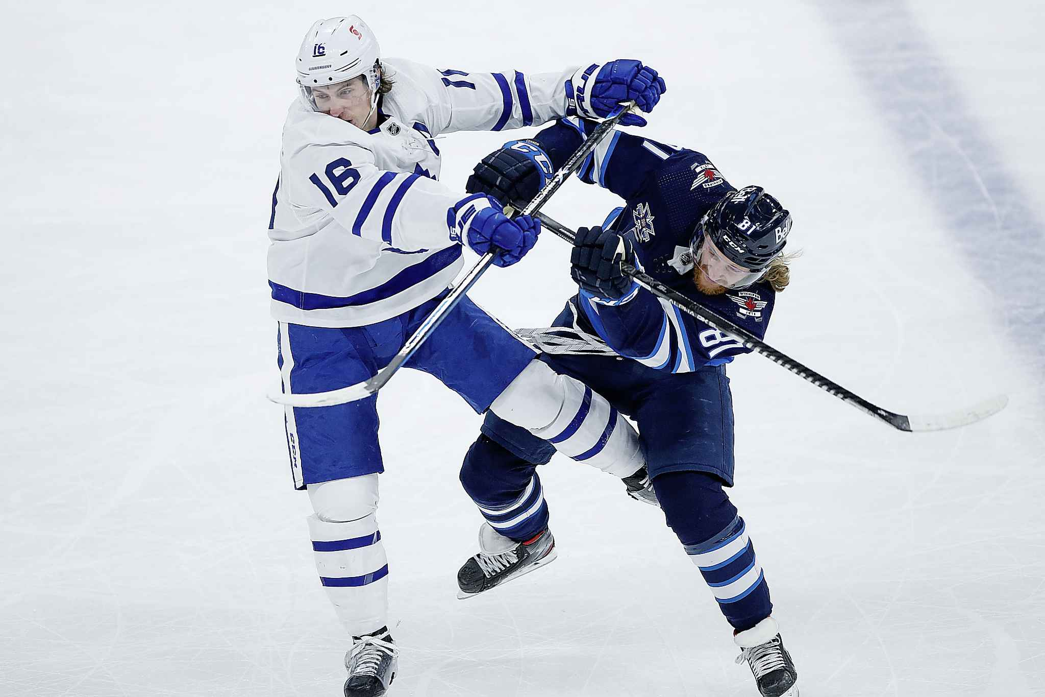 Winnipeg Jets' Kyle Connor (81) and Toronto Maple Leafs' Mitchell Marner (16) collide during the first period. (John Woods / The Canadian Press)