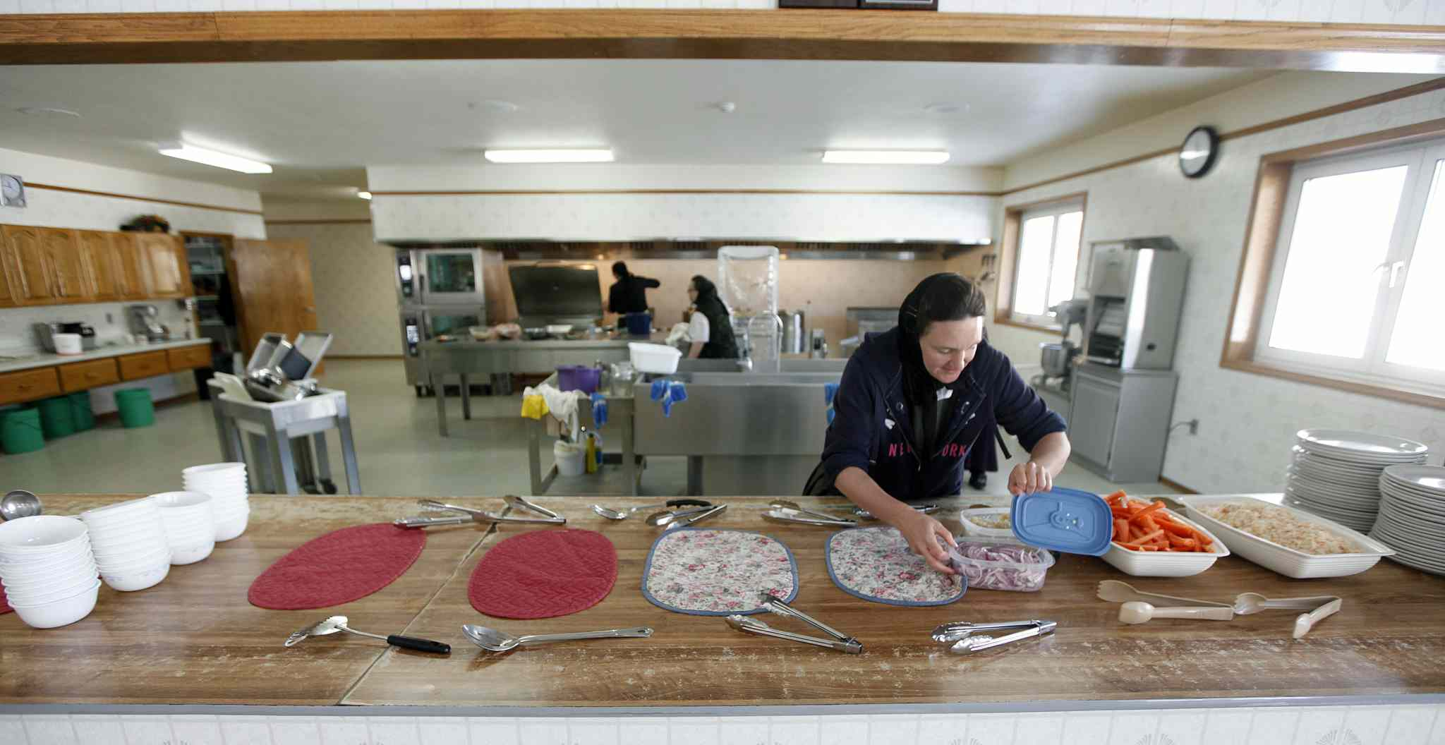 Tizrah Maendel takes her turn preparing daily meals at the colony, where women rotate kitchen duties and the community eats communally.  (Phil Hossack / Winnipeg Free Press)