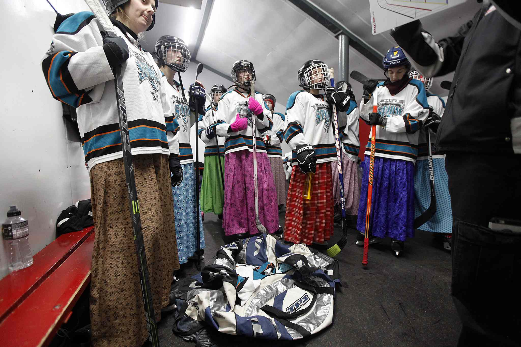 Members of the Baker Storm listen to a little guidance between periods. (Phil Hossack / Winnipeg Free Press)