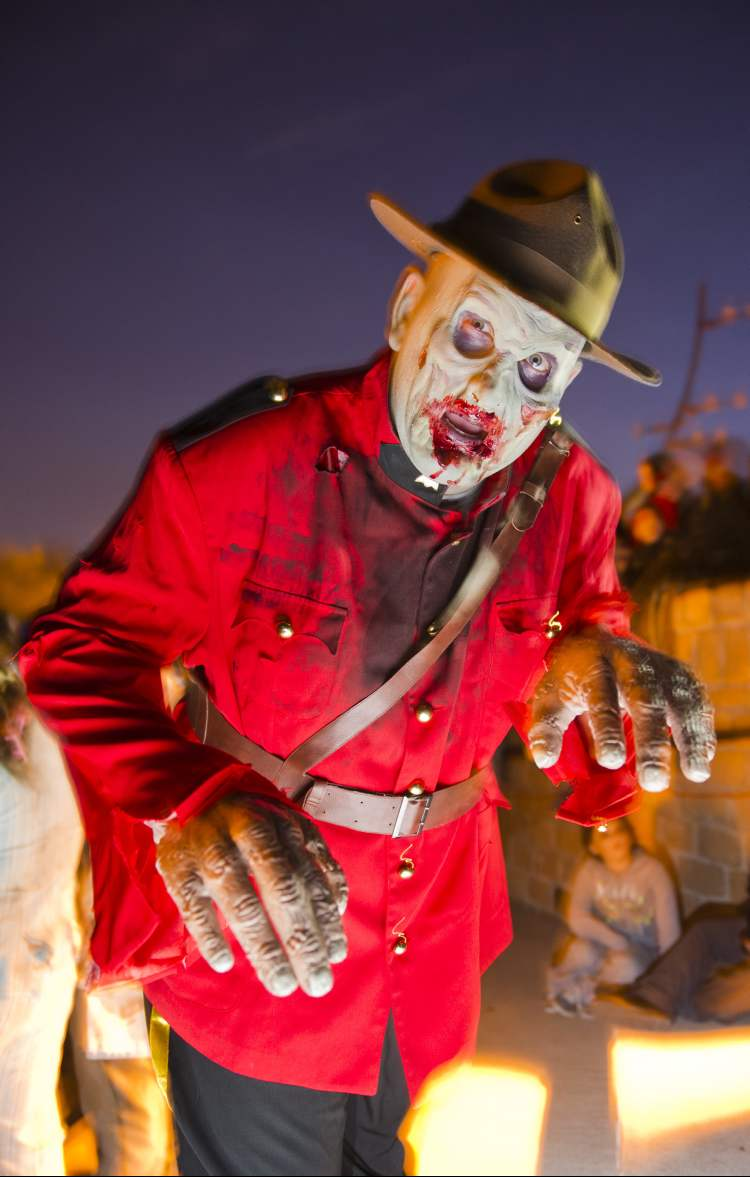 Zombie RCMP officer Mathew MacMillan during the annual Winnipeg Zombie Walk from The Forks to The Manitoba Legislative Building Saturday night.  DAVID LIPNOWSKI / WINNIPEG FREE PRESS