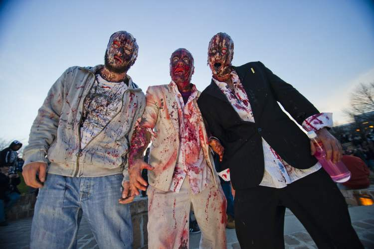 Zombies Paul Burke, Will Burke, and Yannick Gosselin participated in the annual Winnipeg Zombie Walk from The Forks to The Manitoba Legislative Building Saturday night.  DAVID LIPNOWSKI / WINNIPEG FREE PRESS